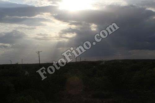 Sun Shining Through Clouds - FotoFino.com