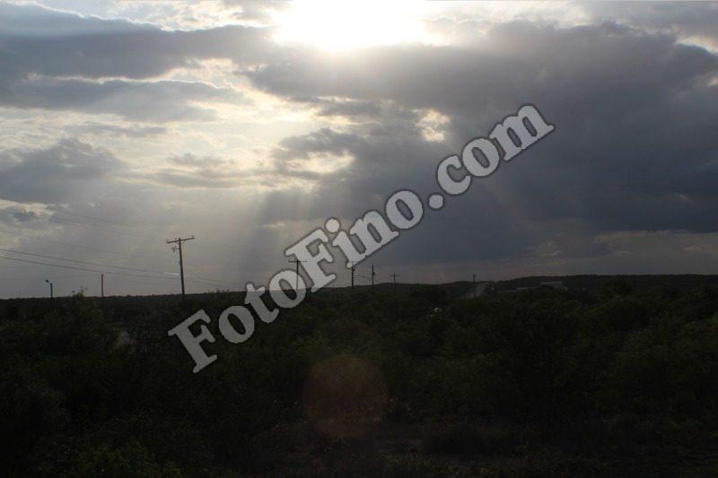 Sun Shining Through Clouds - FotoFino.com